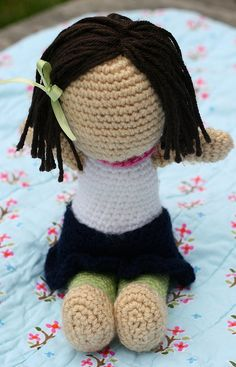 crocheted doll. Link to free pattern and hair tutorial.