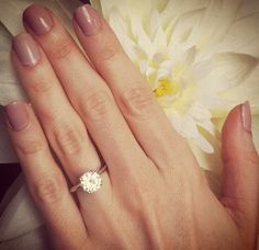 Perfect engagement ring. Classic & simple :) a little bit smaller and it would be perfect. I have baby hands haha