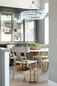 Dining nook, bling chandelier, mirrored cabinet, Klismos chairs