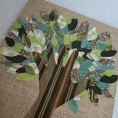 fabric scraps. traced hand. wood covered in burlap. easy.