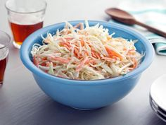 10-Minute Creamy Cole Slaw: Bobby tosses shredded cabbage and carrots with a tangy mixture of mayonnaise and sour cream for the ultimate picnic-ready side dish. #RecipeOfTheDay