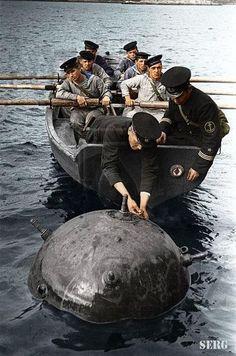 Soviet Sailors with a marine mine.