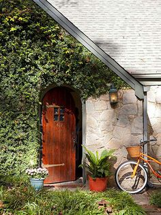 Extra-long hinges, four mini panes of glass, and a curved door top help to reinforce the storybook entrance: http://www.bhg.com/home-improvement/door/exterior/elegant-doors/?socsrc=bhgpin092314doordiscovery&page=3