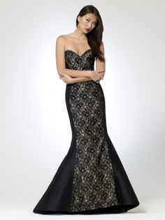 Strapless taffeta and lace mermaid dress with slight train. Beaded detail. Tulle underneath skirt. Support boning. Padded cups. Hidden back zipper. 63 inch body length100% polyester taffetaImportDry clean only