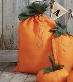 Burlap pumpkin sacks are such a great idea for fall decorations!