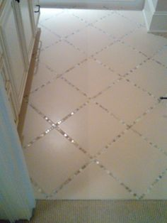 "Lay a thin strip of ""backsplash"" tile in between the large tiles, instead of just using grout... Unexpected. Love this!"