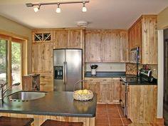 Small, yet plenty of extras in this kitchen - Quailrun Rustic Acadian Home Kitchen from houseplansandmore.com