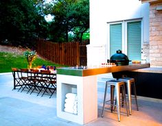 This countertop doubles as a grilling area and bar seating.