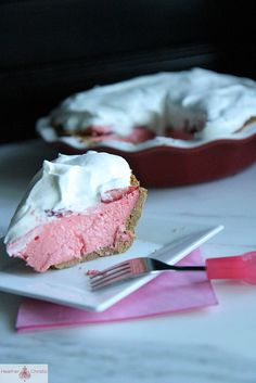 Strawberry Jello Pie....graham cracker crust, filled with strawberry jello and whipped cream, topped with strawberries and whipped cream