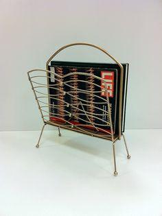 Awesome mid century magazine rack!