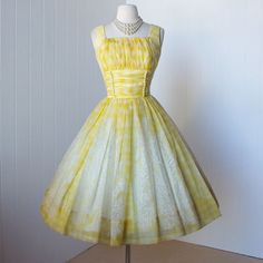 This dress looks like lemonade. And lookit the buttons!