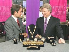 Table of gold jewelry. American antique Gypsy Gold jewelry expert, Barry Webstser.  He was interviewed on Antique Roadshow.