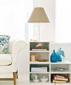 20 Low-Cost Decorating Ideas    Create a Side Table  Stack modular storage units (from $22, amazon.com) to make a stepped side table with surfaces for displays and lighting. Create miniature still lifes in the cubbies, or stack reading material that you're going to get to...someday.