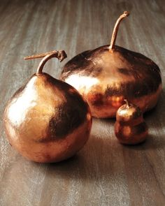 Copper Leaf Gourds  Upgrade a fall gourd to create an inexpensive Thanksgiving table centerpiece.