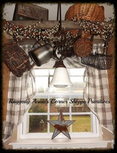 my kitchen window... ladder hung above sink wrapped with pip berries, hanging baskets