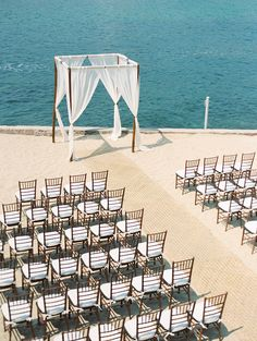 Manicured Beach-front -- simple elegance. See more on Style Me Pretty:  http://www.StyleMePretty.com/destination-weddings/2014/02/28/puerto-vallarta-wedding-at-la-mansion/ Photography: Jillian Mitchell
