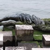 Statue of woman that can only be seen at low tide - it is for women who were killed in WWII - Venice, Italy