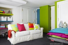 Colorful playroom from My Tiny Nest. Can you see a Pop and Lolli wall decal in here? #popandlolli #pinparty