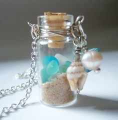 Will be making a necklace like this with sand from all 4 beaches! :)