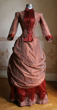 1884 front - Two-piece dress, bodice and skirt in taffeta and satin.  Dress was remade from an 1860s dress of which remains the original bolero. ____ (translated from Italian by Google)