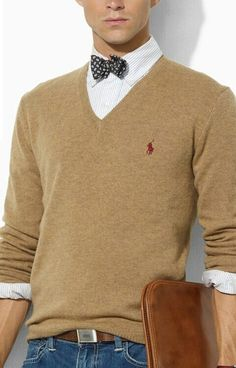 Tan v-neck polo long sleeve shirt. White button down under shirt with a blue pokka dot bow tie. bow ties, collar, polo shirt