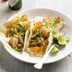 Crispy tilapia is the star of this super easy Fish Tacos with Lime Sauce recipe! Get more easy seafood recipes: http://www.bhg.com/recipes/fish/30-minutes-less/20-quick-easy-seafood-recipes/?socsrc=bhgpin072414fishtacoswithlimesauce&page=3