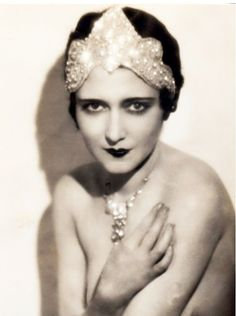 1920's hair and makeup. Elaborate and expensive jewels worn as headpieces added a feminine touch to the short hair.