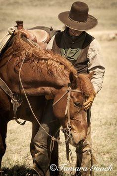 A man & his horse.