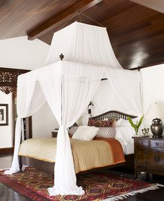 I've always wanted a great big canopy bed, so I can close the curtains at night and have a little cocoon.
