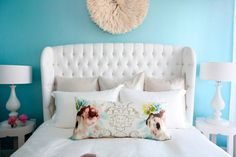 Bed Spread in white with a Winged Chair-esque headboard, floral accents, and Robin Egg Blue walls. I love the simplicity of this.