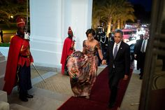 President Obama and the First Lady arrive for an official dinner at the Presidential Palace while traveling in Dakar, Senegal.