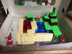 holy smokes.  for Marcus this next year - Minecraft cake I made for my son's 8th Birthday! Tropical Punch Jello for the lava, blue raspberry jello for the water, Rice Krispies for the sand, and a very dense homemade cake for the ground. You will need to make the dense cake to help with not having the crumb fall when cutting into blocks! Also I made a homemade almond buttercream icing! The TNT was made from Twizzlers!!