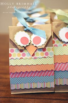"DIY Gift Bags...use a brown paper lunch bag and cut out the ""owl"" face shape.  Then glue strips of scrapbooking paper on the front and for the eyes and beak.  So adorable!!"