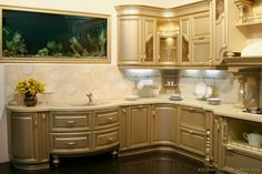 #Kitchen Idea of the Day: A truly unique kitchen with metallic gold cabinets in a curved design, and an aquarium embedded in the wall over the sink! Unique Kitchens.
