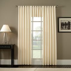 Shorter tabs seem more elegant.  Ellis Curtain Fireside Tab Top Valance modern curtains