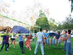 Water Balloon Volleyball for summer parties, pool party ideas, game night, family fun, family reunion games, group games, youth group games, game ideas for teens, office parties, etc.
