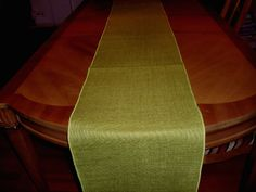 "High quality avocado green 11oz premium burlap sanitized, processed, and dyed to eliminate fray and odor associated with burlap and offered in a serged 14"" x 108"" table runner for that perfect occasion."