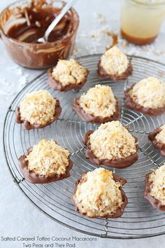 Salted Caramel Toffee Coconut Macaroons on twopeasandtheirpo... They are dipped in chocolate too! The BEST coconut macaroons!
