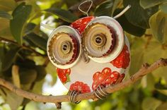 Make owl out of bottle caps and lids