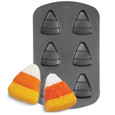 Treat your Halloween tricksters to fun, candy corn-shaped mini cakes! They're easy to make with the Wilton Candy Corn Mini Cake pan.