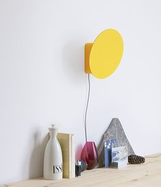 Shutter is a small lamp that can be put either on a table or on a wall. Its indirect light comes from powerful LEDs, hidden in the body, that emit light to a reflective disc. By moving this disc, by opening or closing this box-shaped lamp, user controls the amount and the direction of light.