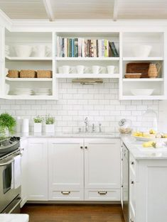 Open cabinets and subway tiles.