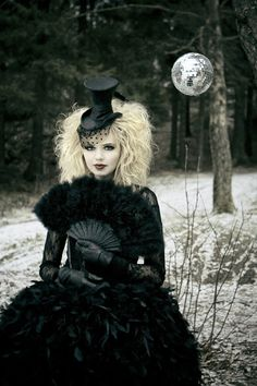 Glam goth, I love it beyond measure! beautiful hat and fan.