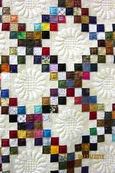 Diamond pattern quilt - great colors - love the quilting in the open space. Stippling is one of my favoritve techniques (very close wavy type pattern)