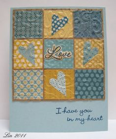 handmade quilt card ... nine patch in blues and yellows .. folkloric shaped punched hearts in the cross .. baroque embossing folder texture ... pretty tiny prints ... like it! ... Stampin'Up!