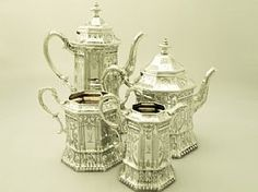 An exceptional, fine and impressive antique Victorian English sterling silver four piece tea and coffee service / set; an addition to our silver teaware collection