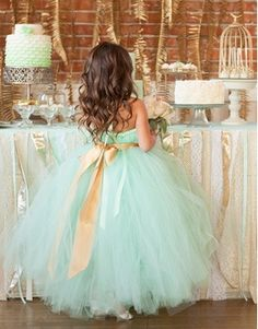 .perfect flower girl dress. For a mint and gold colored wedding.