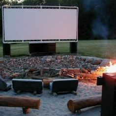 Outdoor movie theatre made of PVC pipe and a tarp. Great thinking.