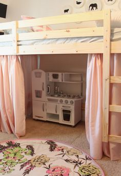 Loft bed with playhouse underneath. Modified from ikea bunk beds. Great to create play space on a small room'