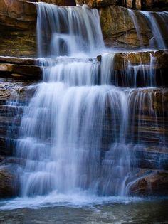 The spillway from Lake Bluestem creates #beautiful cascades in Pawhuska, #Oklahoma. Photo by Steve Overacker.